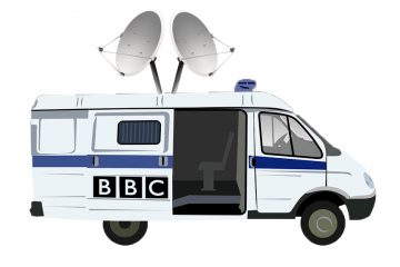 A police van outfitted with satellite antenna and the BBC logo on its sliding door.